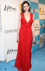 Anne Hathaway wearing a glam long red dress