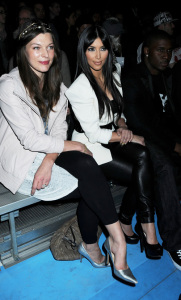 Kim Kardashian and Reggie Bush with Milla Jovovich