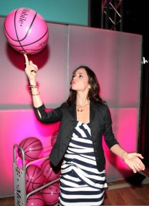 Eliza Dushku plays with a pink basketball at the Launch of the T Mobile myFaves Shot of a Lifetime Sweepstakes on February 13th 2009