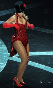 Beyonce Knowels high quality picture of her performance on stage at the 81st Academy Awards wearing a glittery red dancing outfit