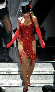 Beyonce Knowels high quality photo of her performance on stage at the 81st Academy Awards wearing a glittery red dancing outfit