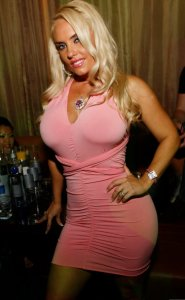Nicole Austin various pictures wears a pink dress