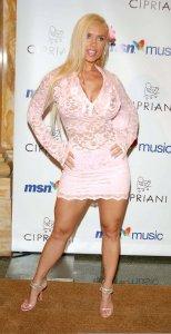Nicole Austin wearing a light pink short dress