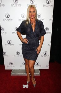 Nicole Austin wears a dark short dress