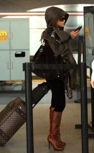 tila tequila paparazzi photo at the airport with her luggage