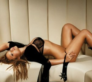 tila tequila photo shoot laying on a white bed couch