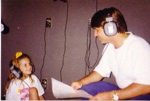 Lara Scandar baby photo with her dad listening to music