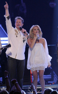 Carrie Underwood performs on stage with Gary DeVox at the 44th annual country music awards on April 5th 2009