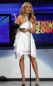 Carrie Underwood onstage with her award at the 44th annual country music awards on April 5th 2009