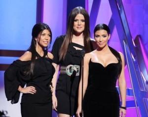 Kim Kardashian with Kourtney Kardashian and Khloe Kardashian on stage at the Bravos 2nd Annual A List Awards on April 5th 2009 2