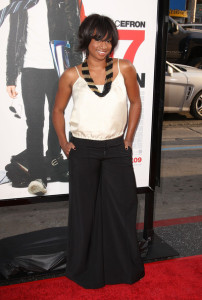 Monique Coleman arrives at the movie premiere of 17 Again on April 14, 2009