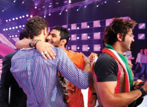 Nasser hugs Michel Azzi as he is voted off the competition at the LBC Star Academy 10th prime on April 24th 2009
