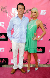 Paris Hilton and Producer Gerry McKean arrive at the My New BFF Season 2 press conference on May 15th 2009 at the Barron Hilton Estate in Bel Air California