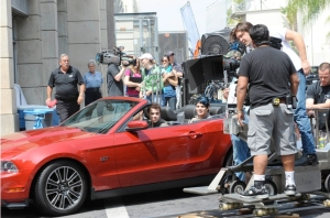 a picture of Kris Allen and Adam Lambert in a red car arriving for the USA Today interview