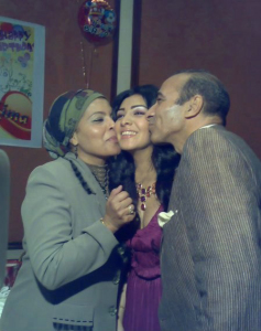 Mirhan Hussein at her birthday party together with her mom and dad