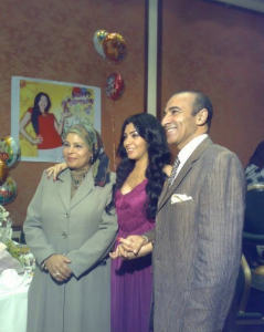 Mirhan Hussein at her birthday party with her mother and father