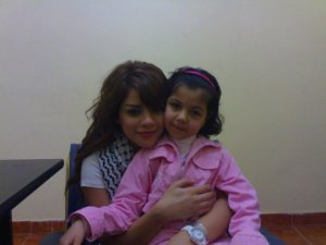Diala Ouda picture with a young lil girl fan