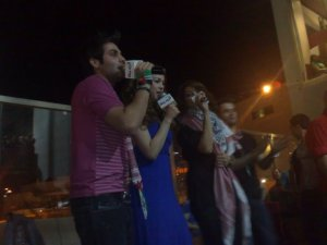 picture of LBC Star Academy season6 students Diala Ouda with Yahia Sweis and Khawla Bent Emran singing live on stage during a live celebration in Amman Jordan in May 2009