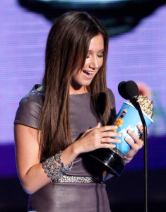 Ashley Tisdale accepts the Breakthrough Female Performance award onstage during the 18th Annual MTV Movie Awards on May 31st 2009