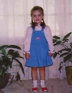 actress Megan Fox childhood pictures as aq little girl wearing a blue dress