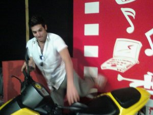 Yahia Sweis photo on a yellow motorbike