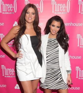 Kim and Khloe Kardashian arrive at the Three O Vodka New Bubble Flavor Launch Party on July 9th 2009 with her sister 1
