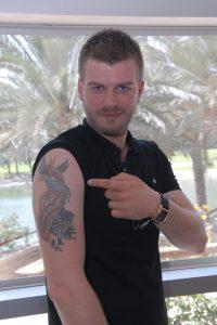 Kivanc Tatlitug photos arm tattoo
