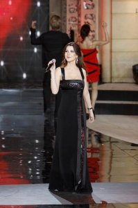 Nancy Ajram pictures performing on stage during the Miss Lebanon 2009 beauty pageant on June 29th 2009 wearing a black glam dress 1