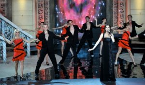 Nancy Ajram pictures performing on stage during the Miss Lebanon 2009 beauty pageant on June 29th 2009 wearing a black glam dress 6