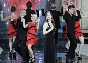 Nancy Ajram pictures performing on stage during the Miss Lebanon 2009 beauty pageant on June 29th 2009 wearing a black glam dress 3