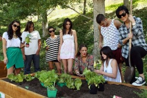 Kim Kardashian picture with her mother Kris Jenner and sisters Kourtney and Khloe Kardashian planting a vegetable garden on August  6th 2009 2