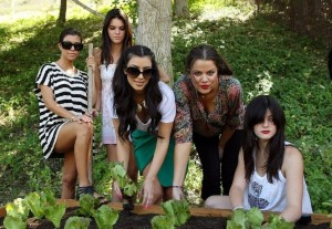 Kim Kardashian picture with her sisters Kourtney and Khloe Kardashian planting a vegetable garden on August  6th 2009 5