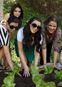 Kim Kardashian picture with her sisters Kourtney and Khloe Kardashian planting a vegetable garden on August  6th 2009 4