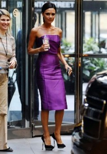 Victoria Beckham arrives at a hotel in Denver wearing a strapless Satin dark voilet dress for American Idol on August 7th 2009