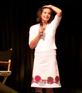 Terry Farrell giving a speech on stage