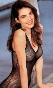 Terry Farrell wearing a black checkered bathing suit