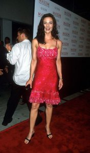 Terry Farrell wearing a red dress
