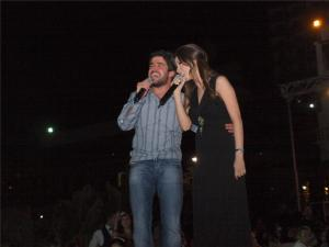 Nancy Ajram onstage during her concert early this week in August 2009 with her brother Nabil Ajram