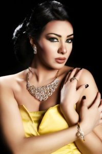 Picture of Mirhan Hussein from Egypt wearing an open cut yellow dress
