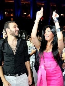Picture of Mirhan Hussein from Egypt on stage singing with Tamer Husni 10