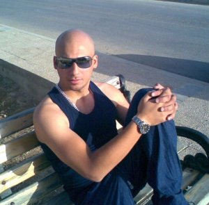 Mohamad Qwaider personal photo sitting on a bench in a sunny day