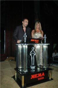 Mohamad Qwaider picture at a public awards event on stage with Reem Ghazali