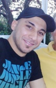 Mohamad Qwaider personal photo wearing a black sport cap