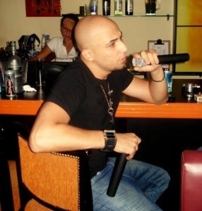 Mohamad Qwaider personal photo singing at a resturant