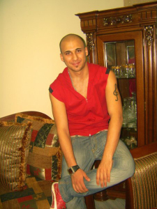 Mohamad Qwaider personal photo wearing a red sweater