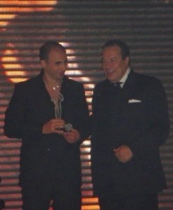 Mohamad Qwaider picture at a public awards event with is award