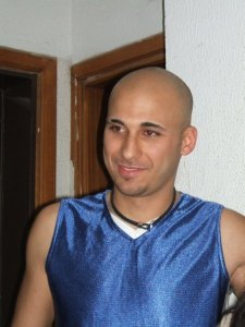 Mohamad Qwaider personal photo wearing a sleevless blue top