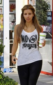 Kim kardashian Spotted wearing a no paparazzi imprinted white tshirt during morning workout which included a fresh milk shake on August 28th 2009 2