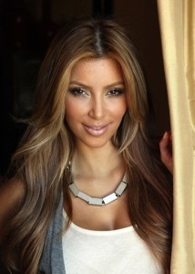 Kim kardashian picture from August 2009 photoshoot of her new high lighted hair style in a pose wearing a silver beaded necklace