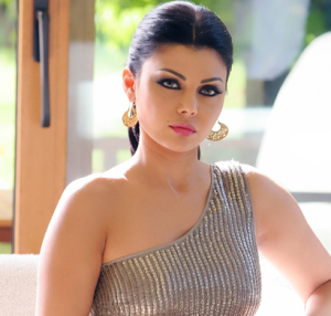 Haifa Wahbi in a one shoulder strapped silver dress